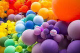Fototapeta Tęcza - Bright abstract background of jumble of rainbow colored balloons celebrating gay pride
