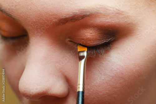 Close up woman getting make up, eyeshadow Poster