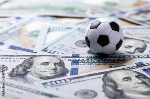 Fotografie, Obraz  Soccer ball on dollar banknotes