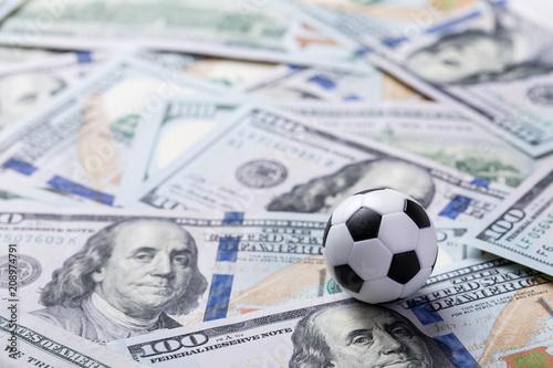 Fotografie, Obraz  Soccer ball on dollar banknotes