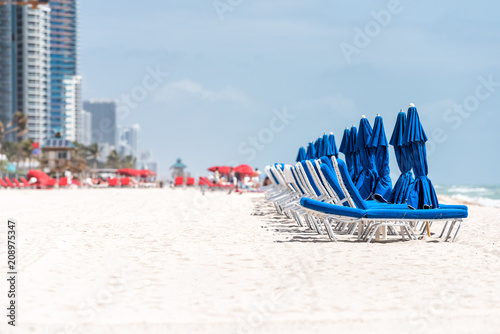 Fotografie, Obraz  Sunny Isles Beach during sunny day in North Miami, Florida, blue and red beach c