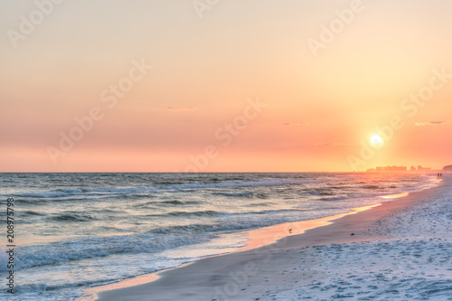Photo Dreamy pink peach orange sunset in Santa Rosa Beach, Florida with Pensacola coas