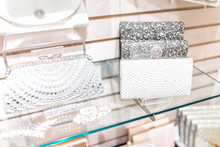 Closeup Of Many Wedding Luxury Expensive Shiny White Purses In Boutique Discount Store, Selection On Shelf Display With Glittering Rhinestones