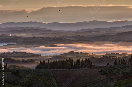 Foto op Canvas Zwart Beautiful rural landscape, Tuscany in autumn sunrise