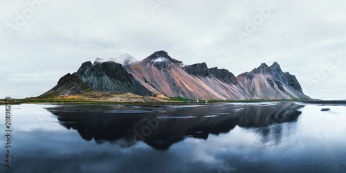 Foto auf Gartenposter Reflexion Famous Stokksnes mountains reflected in water on Vestrahorn cape, Iceland.
