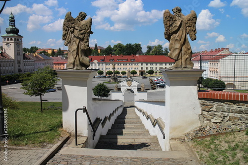 Poster Historisch mon. Steps from Most Holy Trinity church to Komenskeho square with town hall (left) in Fulnek, Czech republic