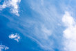 White clouds on a dark blue sky, fantastic contrast, background