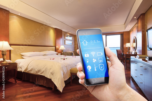 mobile phone with smart home app in modern bed room