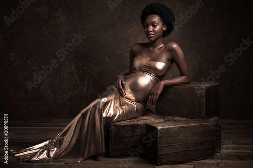 Woman in gold gown