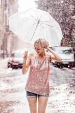 Smiling Girl With Umbrella Pos...