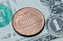 US Coin One Cent On One Dollar Bill