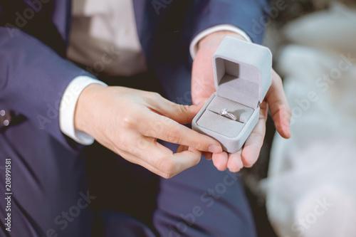 Cuadros en Lienzo Man open a diamond ring box for marry his girlfriend.