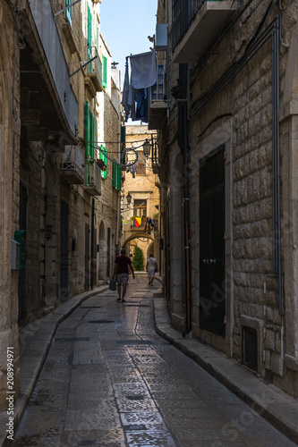 Foto auf Gartenposter Schmale Gasse A narrow typical street in the old town of Trani, Apulia, Italy