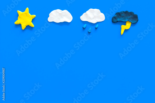 Obraz Modern weather icons set on blue background top view copy space - fototapety do salonu