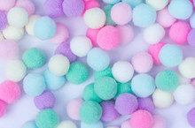 A Colorful  Pom Pom Background