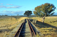Old Abandoned Crooked Rusty Railway Tracks On Historic Bridge Over The Boorowa River Through Rural Central West NSW, Australia