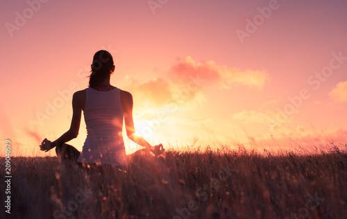 Fotobehang School de yoga Peaceful quiet meditation. Woman meditating in a grass meadow.
