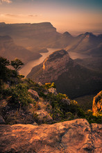 Portrait Shot Of Blyde River Canyon Bathed In Dreamy Warm Pinks And Oranges During Pre-sunset Golden Hour. Foreground Rock. Mpumalanga, South Africa