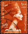 Head of Nefertiti on red egyptian postage stamp