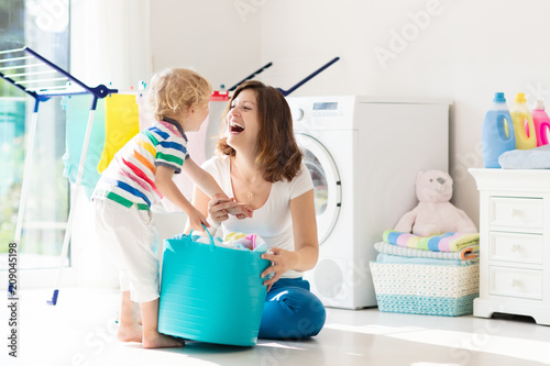 Family in laundry room with washing machine