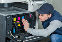 Young Male Technician Repairing Digital Photocopier Printer Machine