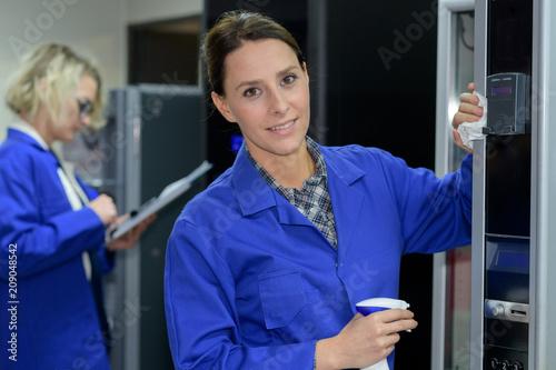 female janitor spraying and posing Fototapeta