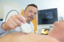 Doctor Performing Ultrasound O...