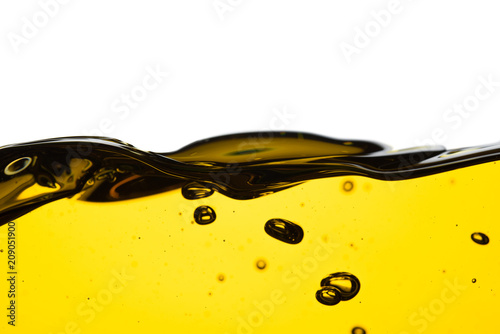 Tablou Canvas Pouring oil car motor or olive vegetable cooking and bubble isolated on white ba