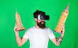 canvas print picture - Man with hipster beard in VR glasses holding 3D models of Big Ben and Empire State Building. Bearded man watching interactive documentary about world heritage sites, virtual trip, educational concept