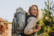 Woman With Backpack Hiking In ...