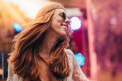 Beautiful hippie woman enjoying at music festival Canvas Print