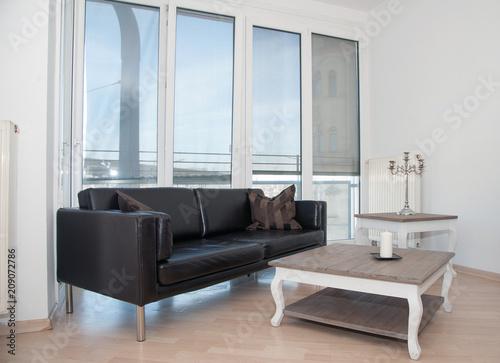 Wohnzimmer Couch Sofa Und Tisch Vor Fensterfront Buy This Stock