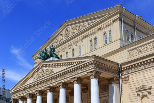 Foto op Canvas Theater Facade of Bolshoi Theatre closeup on a blue sky background on a sunny summer morning