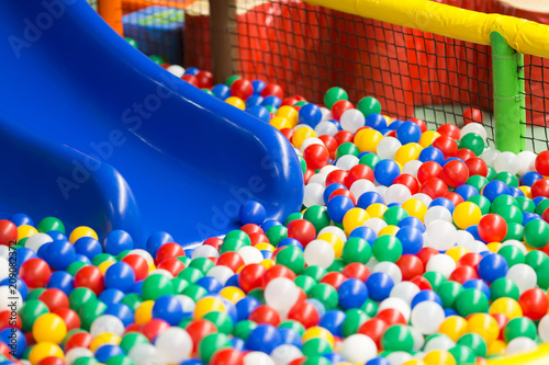 Foto op Plexiglas Fitness Modern children playground interior. Colored plastic balls pool with a blue hill. Selective focus