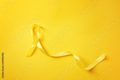 Fotografie, Obraz Yellow ribbon on color background. Cancer concept