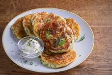 Mashed Potato And Cheese Cakes, Served With Sour Cream Or Yogurt. Potato Pancakes, Fritters. Horizontal