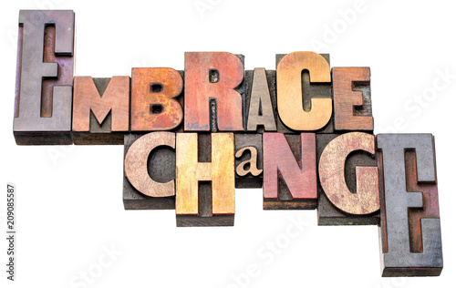 Photo embrace change word abstract in wood type