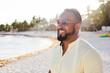 Ethnic man posing on beach