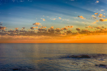 Golden South African Idyllic Scenic Sunset On The Coast Over The Sea Near Cape Town South Africa, Sun Rays And Clouds Over A Calm Ocean