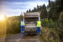 Workers Collect Garbage In The...