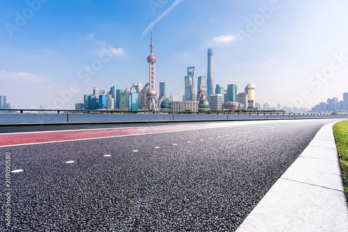 empty asphalt road with modern office building Poster