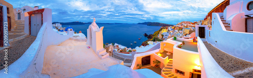 Foto auf Leinwand Santorini Oia town on Santorini island, Greece. Traditional and famous houses and churches with blue domes over the Caldera, Aegean sea