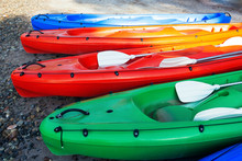 Closeup View Of Colorful Canoe Boats On The Beach, Ready For Use. Sunny Day