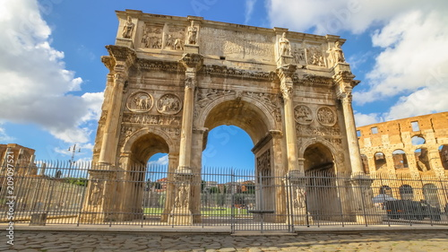 Artistique sunset with clouds of Arch of Constantine, located between Colosseum and the Arch of Titus on the Roman road, built to celebrate the triumph of the emperor Constantine. Rome, Italy.
