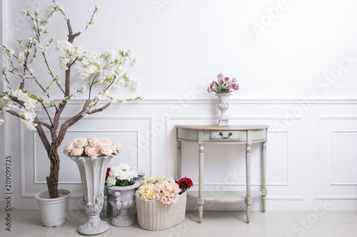 Obraz Elegant interior decoration with flowers on  white wedding background - fototapety do salonu