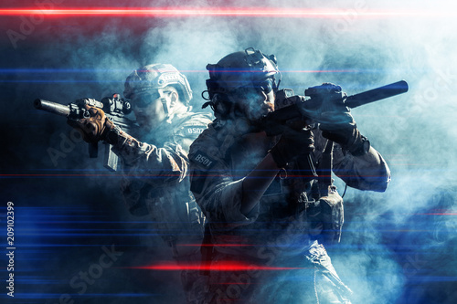 Fotografering Group of security forces in Combat Uniforms with rifles