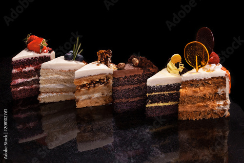 Stampa su Tela Assorted large pieces of different cakes: chocolate, raspberries, strawberries, nuts, blueberries
