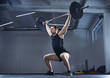 Man doing barbell exercise at gym during weight lifting workout