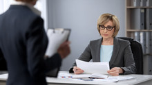 Serious Businesswoman Strictly Looking At Secretary, Poor Performance, Bad Work