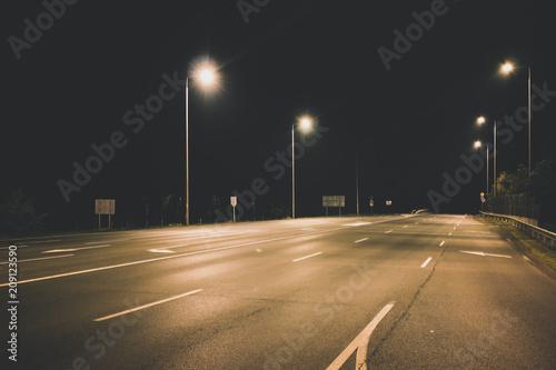 Foto op Plexiglas Nacht snelweg night empty highway under lanterns light concept